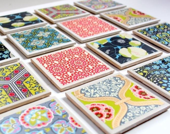 Picture of Tiles that have scrapbook paper modpodged on top and turned into coasters