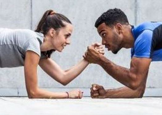 Two People Armwrestling